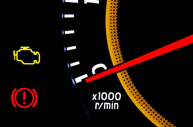 check engine light and odometer with warning light